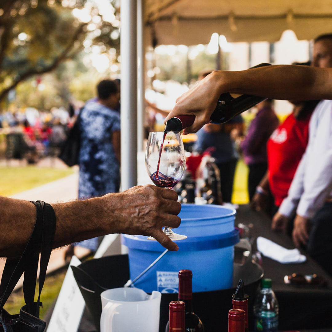Pouring wine at Banners Rouge et Blanc 2018 at McNeese